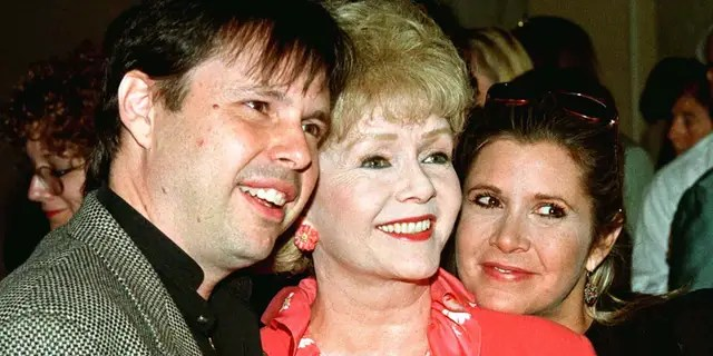 Actress Debbie Reynolds (C) and son, filmmaker Todd Fisher, and daughter, screenwriter Carrie Fisher.