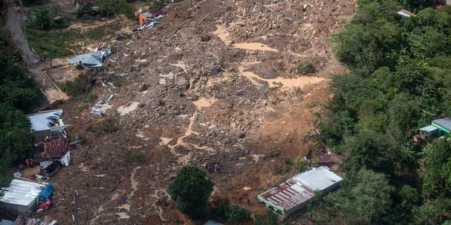 An aerial view of the huge, rain-fed landslide in the village of Queja, Guatemala, Saturday, November 7, 2020, in the aftermath of Tropical Storm Eta.
