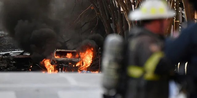 A vehicle burns near the site of an explosion in the area of Second and Commerce in Nashville, Tennessee, U.S. December 25, 2020. (Andrew Nelles/Tennessean.com/USA Today Network via Reuters)