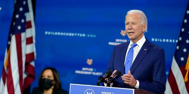 President-elect Joe Biden speaks as Vice President-elect Kamala Harris listens at left, during an event to introduce their nominees and appointees to economic policy posts at The Queen Theater in Wilmington, Del.