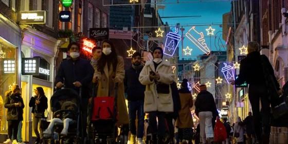 Shoppers walk through Kalverstraat in Amsterdam, Netherlands, Monday December 14, 2020. (AP Photo / Peter Dejong)
