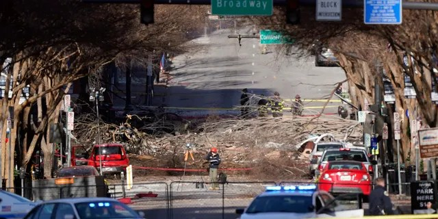 Investigators continue to examine the site of an explosion Sunday, Dec. 27, 2020, in downtown Nashville, Tenn. (AP Photo/Mark Humphrey)