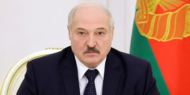 Belarusian President Alexander Lukashenko attends a meeting on the work of the economy in the current year in Minsk, Belarus, Monday, Dec. 7, 2020. (Maxim Guchek/BelTA Pool Photo via AP)