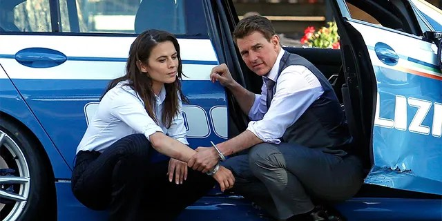 Actor Tom Cruise and actress Hayley Atwell handcuffed together on the set of the film 'Mission: Impossible 7' at Imperial Fora in Rome, Italy, October 13, 2020.
