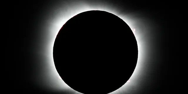 The moon covers the sun during a total solar eclipse in Piedra del Aguila, Argentina, Monday, Dec. 14, 2020.