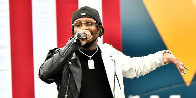 """STONECREST, GEORGIA - DECEMBER 28: Rapper BRS Kash performs onstage during the """"Vote GA Blue"""" concert for Georgia Democratic Senate candidates Raphael Warnock and Jon Ossoff on December 28, 2020 in Stonecrest, Georgia. (Photo by Paras Griffin/Getty Images)"""
