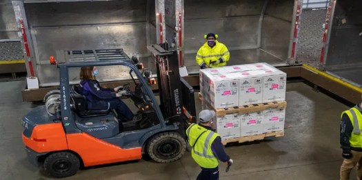 FedEx workers transport vaccine doses in Grand Rapids, Mich. (FedEx)