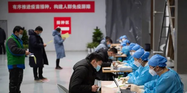 In this photo released by the Xinhua News Agency, residents at a temporary vaccination site in Beijing on Saturday, January 2, 221, have filled out material forms before their COVID-19 vaccinations.  December 31, 2020, adding a second shot, can be seen widespread use in poor countries, as the virus spreads back around the world.  (By Chen Zhongoo / Xinhua AP)