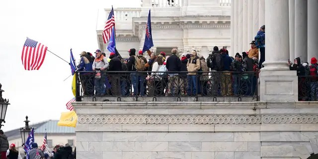 Trump supporters gather outside the Capitol, Wednesday, Jan. 6, 2021, in Washington. As Congress prepares to affirm President-elect Joe Biden's victory, thousands of people have gathered to show their support for President Trump and his claims of election fraud. (AP Photo/Manuel Balce Ceneta)