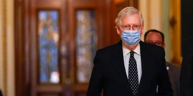 Senate Majority Leader Mitch McConnell of Ky., walks from the Senate floor to his office on Capitol Hill Wednesday, Jan. 6, 2021, in Washington. (AP Photo/Manuel Balce Ceneta)
