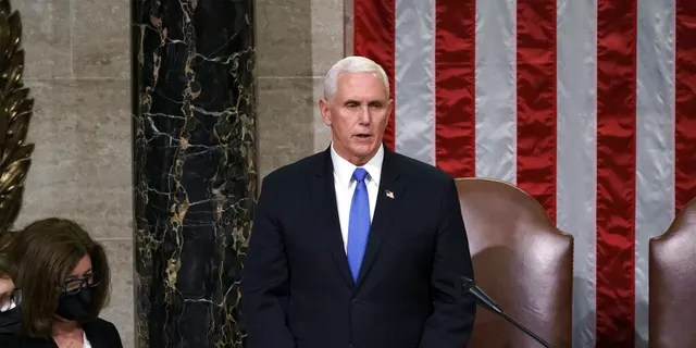 Vice President Mike Pence listens after reading the final certification of Electoral College votes cast in November's presidential election during a joint session of Congress after working through the night, at the Capitol in Washington, Jan. 7.