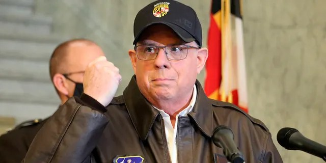 Maryland Gov. Larry Hogan holds his hand up during a news conference in Annapolis, Md., on Thursday, Jan. 7, 2021. Hogan visited the White House Friday to discuss coronavirus relief with President Biden. (AP Photo/Brian Witte)
