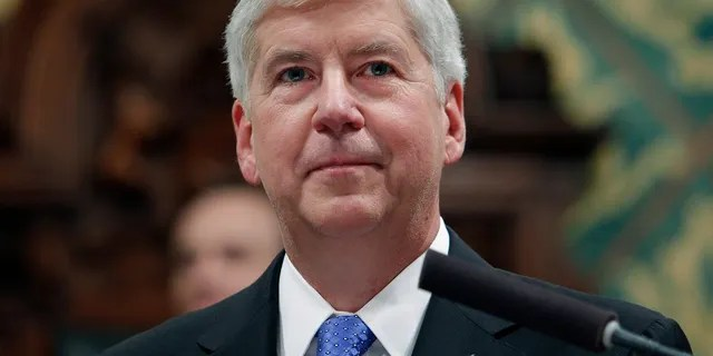 In this Jan. 23, 2018, file photo, former Michigan Gov. Rick Snyder delivers his State of the State address at the state Capitol in Lansing, Mich. Snyder, Nick Lyon, former director of the Michigan Department of Health and Human Services, and other ex-officials have been told they're being charged after a new investigation of the Flint water scandal, which devastated the majority Black city with lead-contaminated water and was blamed for a deadly outbreak of Legionnaires' disease in 2014-15, The Associated Press has learned. (AP Photo/Al Goldis, File)