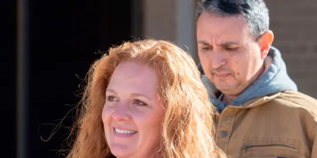 Jenny Cudd, front, a flower shop owner and former Midland mayoral candidate, and Eliel Rosa leave the federal courthouse in Midland, Texas, Wednesday, Jan. 13, 2021. The FBI arrested Cudd and Rosa on Wednesday in connection with the Jan. 6 insurrection at the U.S Capitol. (Tim Fischer/Reporter-Telegram via AP)