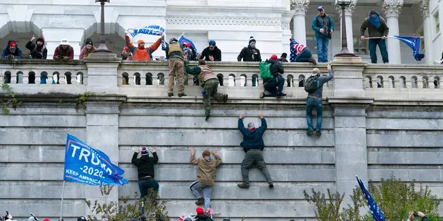FILE: Supporters of President Donald Trump scale the west wall of the the U.S. Capitol in Washington.