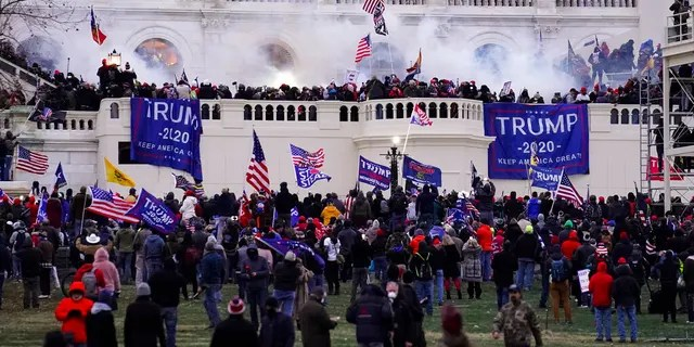 FILE: Violent rioters, loyal to President Donald Trump, storm the Capitol in Washington.