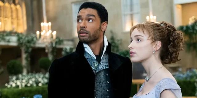 Regé-Jean Page portrays Simon Basset, Duke of Hastings in Netflix's 'Bridgerton' alongside Phoebe Dynevor as Daphne Bridgerton.