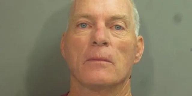 Richard Barnett, 60, allegedly broke into House Speaker Nancy Pelosi's officeduring a riot inside the U.S. Capitol on Wednesday.(- Washington County, Arkansas)