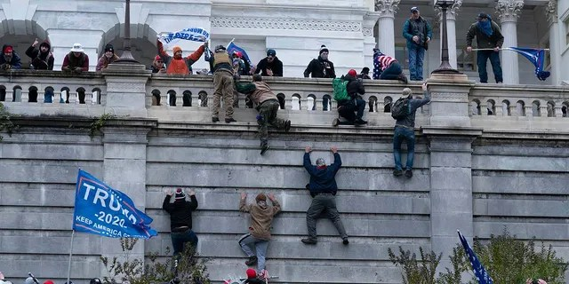 Supporters of former President Donald Trump climb the west wall of the US Capitol on Wednesday, January 6, 2021 in Washington.  (AP Photo / Jose Luis Magana)