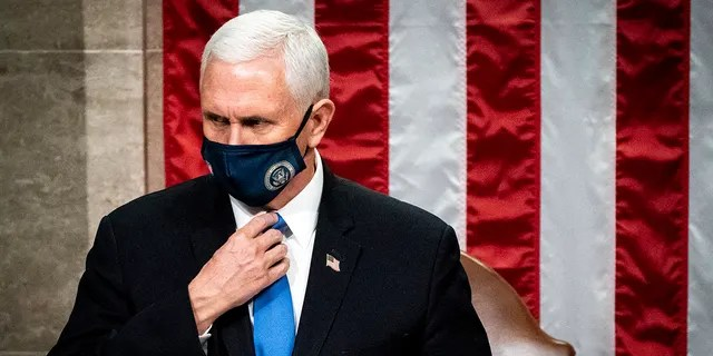 Vice President Mike Pence officiates as a joint session of the House and Senate reconvenes to confirm the Electoral College votes at the Capitol, Wednesday, Jan 6, 2021. (Associated Press)