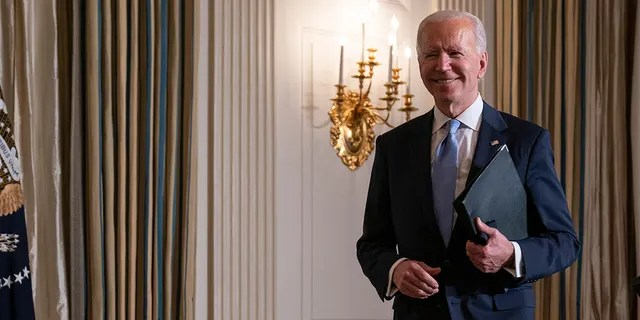 President Joe Biden leaves after attending a virtual swearing in ceremony of political appointees from the State Dining Room of the White House on Wednesday, Jan. 20, 2021, in Washington. (AP Photo/Evan Vucci)