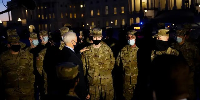 Vice President Mike Pence speaks to National Guard troops outside the U.S. Capitol, Thursday, Jan. 14, 2021, in Washington. (AP Photo/Alex Brandon, Pool)