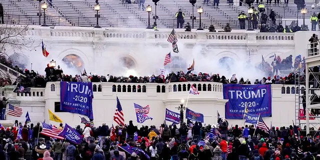 Violent protesters, loyal to former President Donald Trump, storm the Capitol, Wednesday, Jan. 6, 2021, in Washington. (AP Photo/John Minchillo)