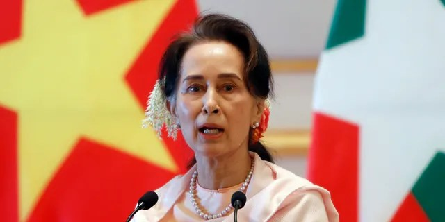 FILE - On December 17, 2019, file photo, Myanmar President Nguyen Xuan Phuke spoke to Myanmar's leader Aung San Suu Kyi during a joint press conference after a meeting at the Rashtrapati Bhavan in Myanmar's Presidential Negueta.  Reports said that a military coup took place in Myanmar on Monday, February 1, 2021, and Suu Kyi was placed under house arrest.  (AP Photo / Ang Shine Oo, File)