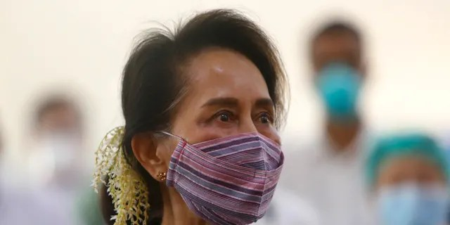 FILE - In this January 27, 2021, file photo, Myanmar leader Aung San Suu Kyi witnessed the vaccination of health workers at the hospital in Nayapita, Myanmar.  Reports said that a military coup took place in Myanmar on Monday, February 1, 2021, and Suu Kyi was placed under house arrest.  (AP Photo / Ang Shine Oo, File)