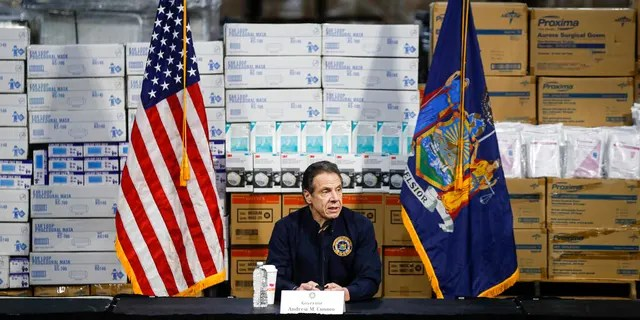 FILE: Gov. Andrew Cuomo speaks during a news conference against a backdrop of medical supplies at the Jacob Javits Center that will house a temporary hospital in response to the COVID-19 outbreak in New York.