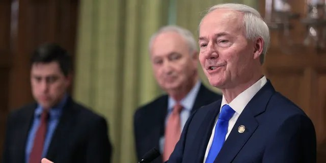 In this March 23, 2020 file photo, Gov. Asa Hutchinson, right, speaks in Little Rock, Ark. (Staton Breidenthal/The Arkansas Democrat-Gazette via AP, File)