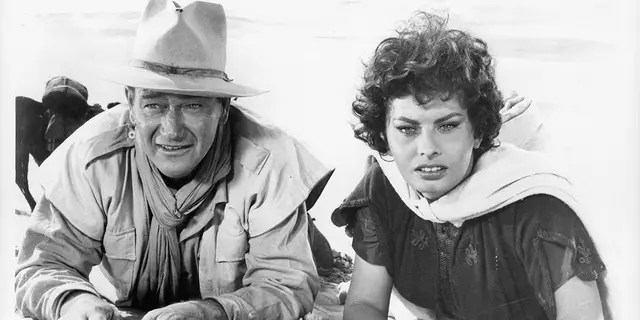 John Wayne and Sophia Loren were found in the sand in a scene in the 1957 film Legend of the Lost.
