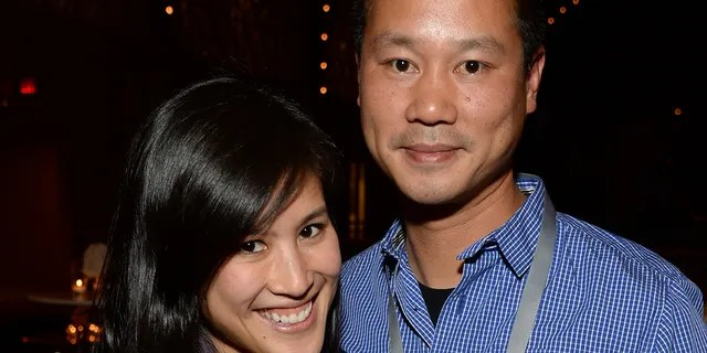SAN FRANCISCO, CA - OCTOBER 08: Mimi Pham and Zappos.com CEO Tony Hsieh attend the Vanity Fair New Establishment Summit Cockatil Party on October 8, 2014 in San Francisco, California. (Photo by Michael Kovac/Getty Images for Vanity Fair)