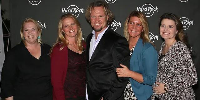 Kody Brown (C) and his wives, (L-R) Janelle Brown, Christine Brown, Meri Brown and Robyn Brown.