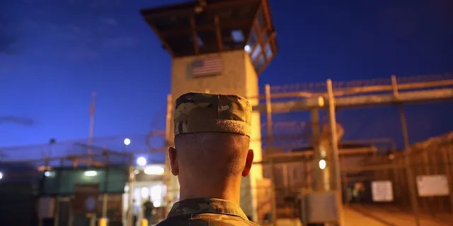 "A US Army soldier stands outside the entrance of the ""Gitmo"" detention center on October 22, 2016 at the US Naval Station in Guantanamo Bay, Cuba.  (Getty Images)"