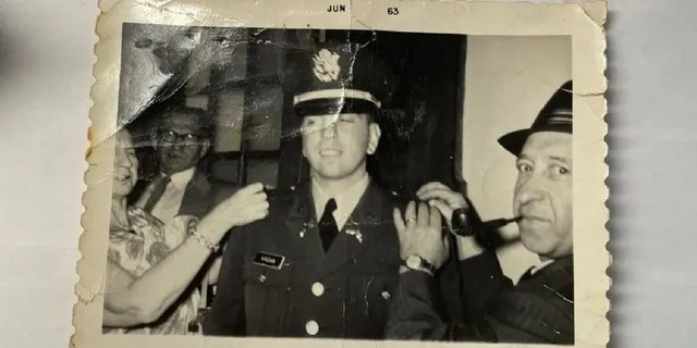 Seymour Kagan's mother and father pinned their second lieutenant bars on their uniforms after graduating from Rutgers University's ROTC program in 1963.  His uncle is seen in the background.  (Courtesy Seymour Kagan)