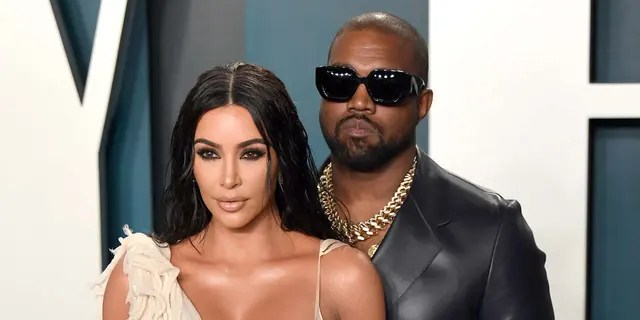 Between Kim Kardashian (left) and Kanye West (right) and a divorced divorcee.  (Photo by Karvai Tang / Getty Image)