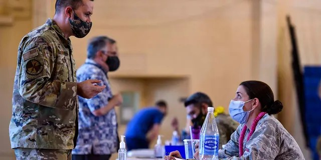 In this February 9, 2021 photo provided by the Department of Defense, the Hickm 15th Medical Group hosted the first COVID-19 mass vaccination at Joint Base Pearl Harbor-Hickm.  (US Air Force Tech. Sgt. Anthony Nelson Jr. Dept. of Defense via AP)