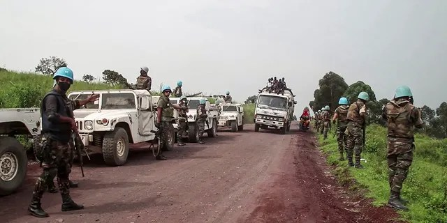 From this image, the UN peacekeepers defend the area where the UN convoy was attacked.  (AP Photo / Justin Kabumba)