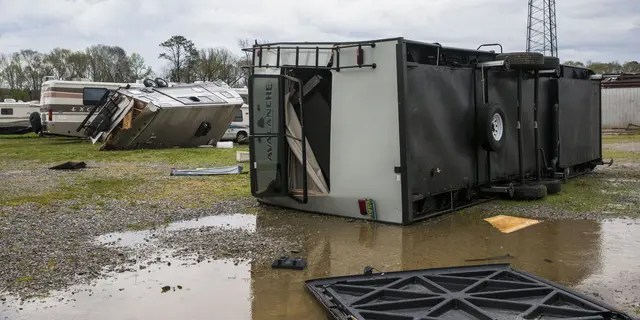 AMU RV service and repair on Old Greensboro Road was struck by a tornado that destroyed multiple client-owned recreational vehicles, Wednesday, March 17, 2021, in Moundville, Ala. The tornado also tore the roof off the workshop with people inside, who survived. A wave of storms is pounding the Deep South, leaving a trail of splintered trees and damaged buildings. And forecasters said still more severe weather was on the way Wednesday with the potential for massive tornadoes, downpours and hail the size of tennis balls. (AP Photo/Vasha Hunt)