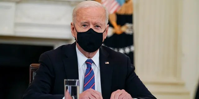 President Joe Biden meets with Vice President Kamala Harris, Health and Human Services Secretary Xavier Becerra and Homeland Security Secretary Alejandro Mayorkas in the State Dining Room of the White House, Wednesday, March 24, 2021, in Washington. (AP Photo/Evan Vucci)