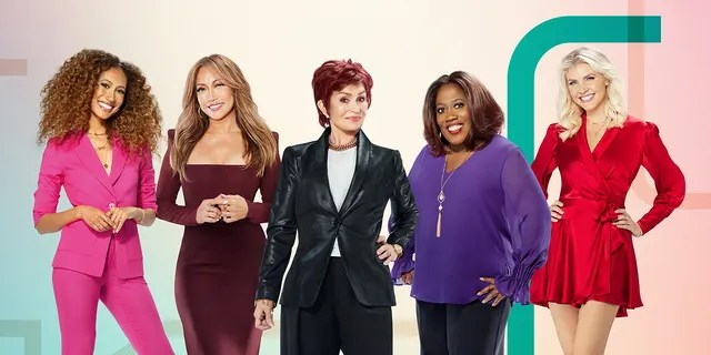 Sharon Osbourne, center, decided to leave 'The Talk' after an on-air spot on March 26 in purple with co-host Sheryl Underwood.  (Randy St. Nicholas / CBS © 2021 CBS Broadcasting, Inc. All rights reserved.)