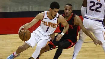 Booker scores 36 as Suns beat Rockets for 6th straight win