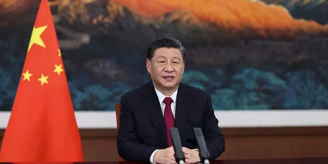 In this photo released by Xinhua News Agency, Chinese President Xi Jinping delivers a keynote speech via video for the opening ceremony of the Boao Forum for Asia (BFA) Annual Conference, in Beijing Tuesday, April 20, 2021. Xi's China and Russia pose growing threats to Western countries in the Arctic, according to American and Canadian officials. (Ju Peng/Xinhua via AP)