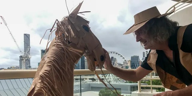 David Marriott used brown paper bags to turn himself into a paper cowboy during his two-week quarantine in a hotel in Australia. (David Marriott via AP)