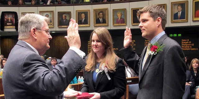 FILE - In this Nov. 20, 2012, file photo State Sen. Don Gaetz, R-Niceville, left, is sworn in as Senate president by his son, state Rep. Matt Gaetz, R-Fort Walton Beach, as his daughter, Erin, holds the family bible on Tuesday, Nov. 20, in Tallahassee, Fla. (AP Photo/Bill Cotterell, File)