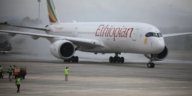 Officials spray disinfectant on an Ethiopian Airlines plane in this September 2020 photo.
