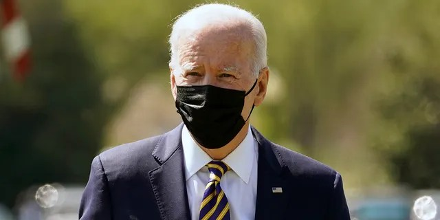 President Biden walks over to speak to members of the media after arriving on the Ellipse on the National Mall after spending the weekend at Camp David, Monday, April 5, 2021, in Washington. (AP Photo/Evan Vucci)
