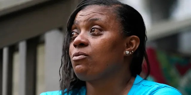 Tammie Townsend tears up as she speaks about her eldest son, Willie Jones Jr., and his attentiveness and love for his son at the family home in Forest, Miss., April 27, 2021. Jones, was 21 when he was found hanging from a tree in his girlfriend's Scott County yard three years ago. A Hinds County judge recently awarded the family $11 million in a civil suit related to his death. (AP Photo/Rogelio V. Solis)
