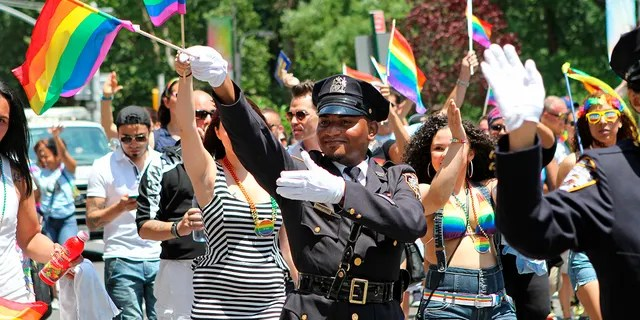 NYPD police officers march along Fifth Avenue during the gay pride parade in New York City, June 29, 2014. (Associated Press)